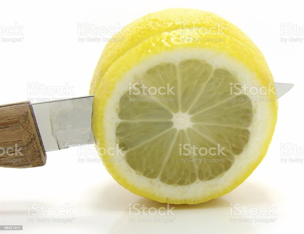 lemon and knife royalty-free stock photo