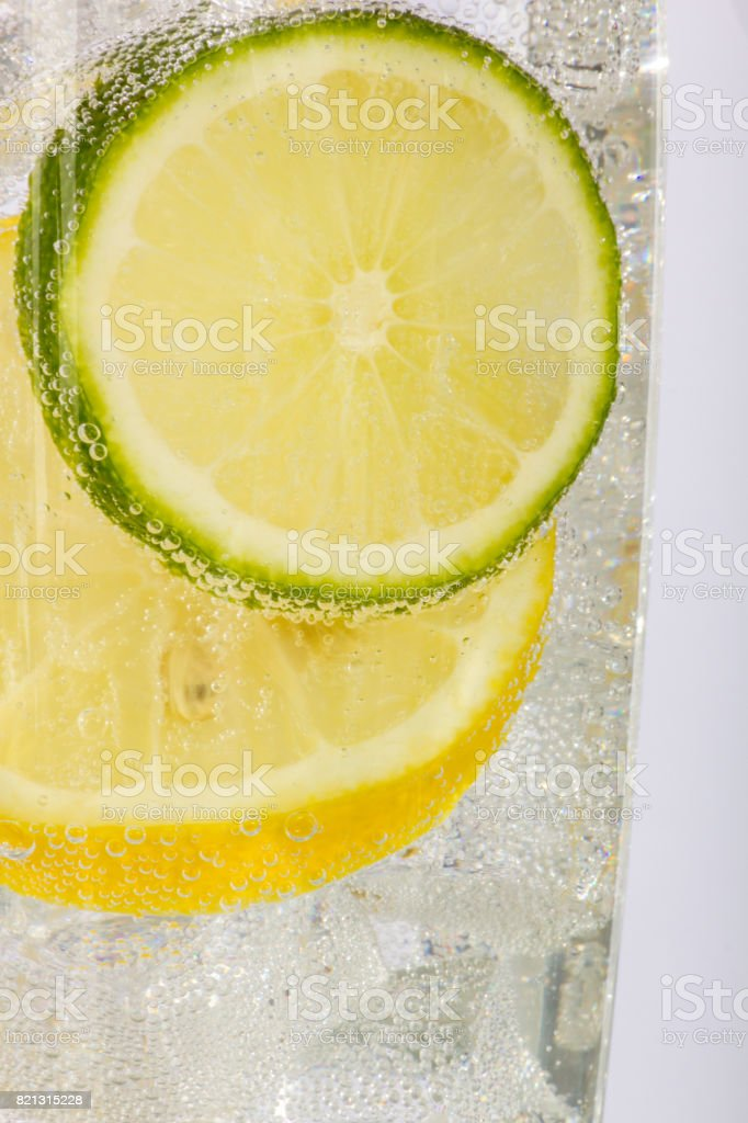 Lemon and Lime Slices with Bubbles in Soda Water stock photo