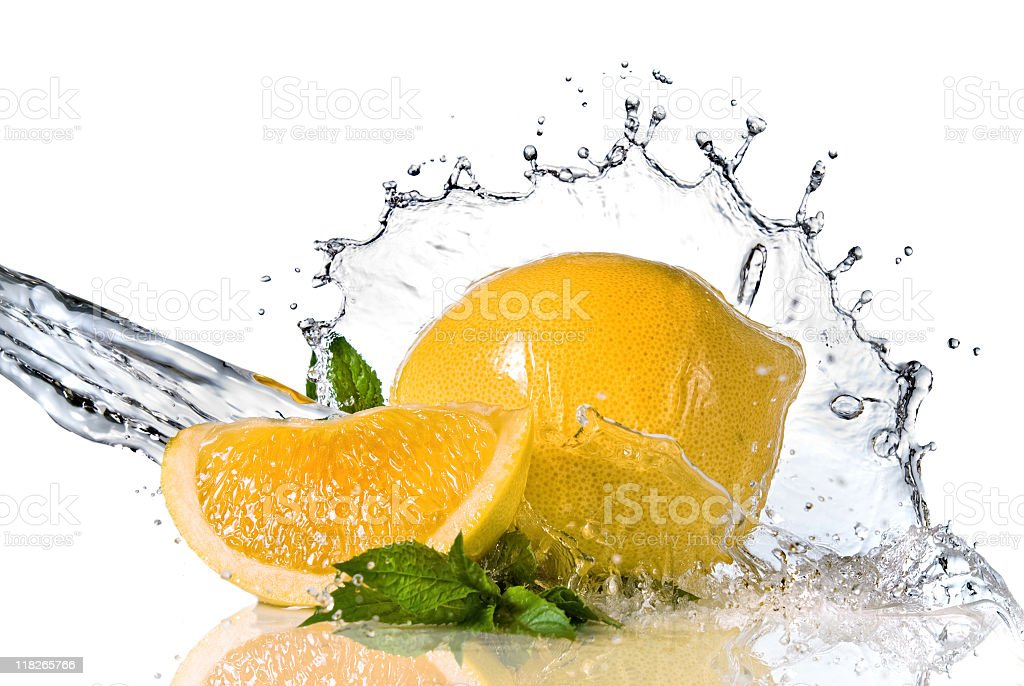 Lemon and mint being splashed with water stock photo