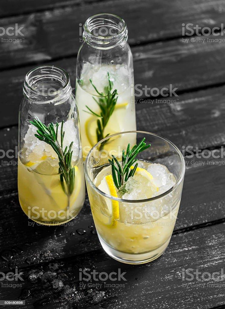 Lemon and rosemary homemade lemonade. Healthy refreshing drink stock photo