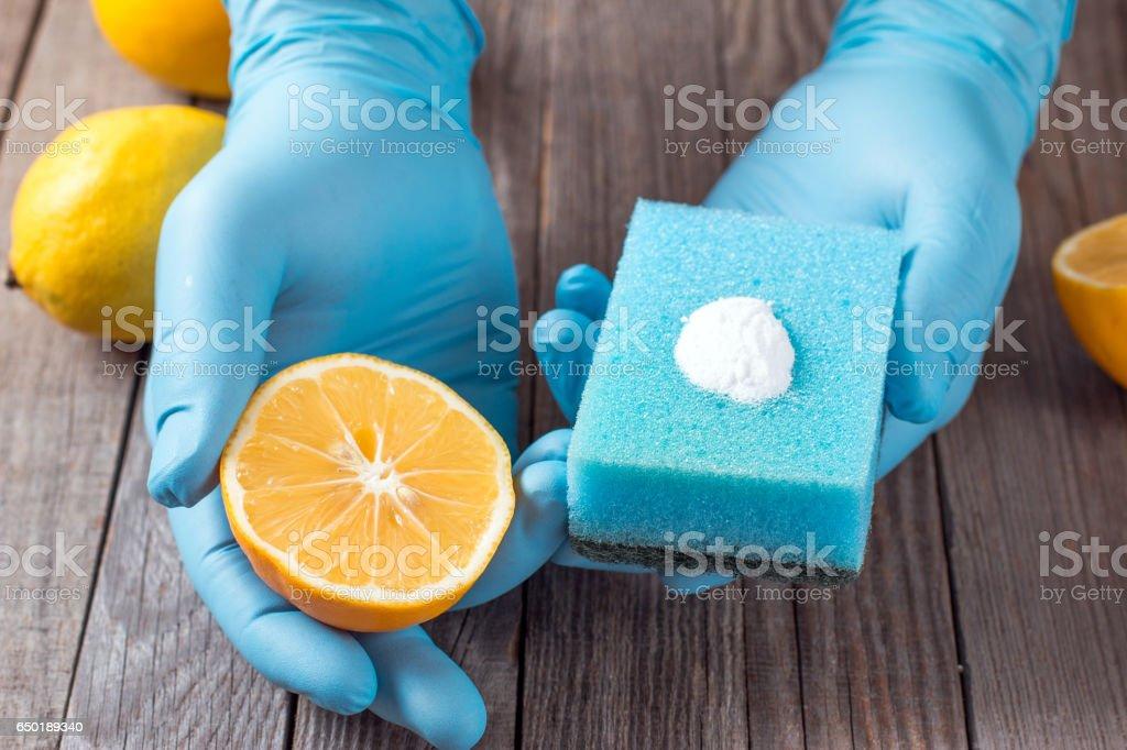 lemon and sodium bicarbonate in hand stock photo
