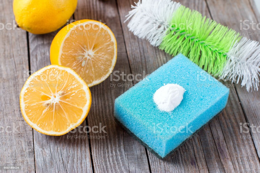 lemon and sodium bicarbonate on wooden table stock photo