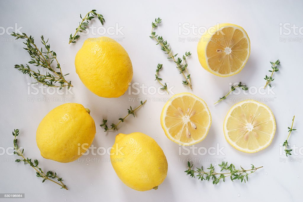 lemon and thyme on white background stock photo