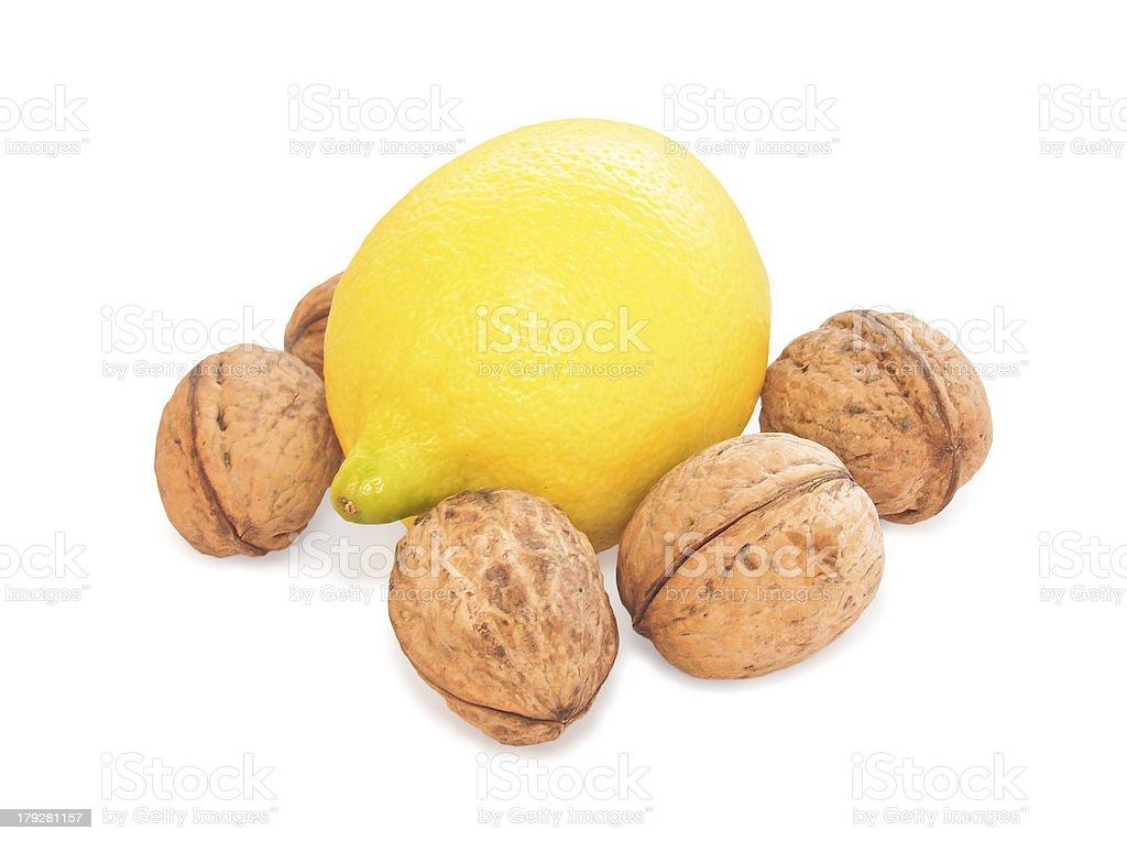 Lemon and walnut on white background royalty-free stock photo