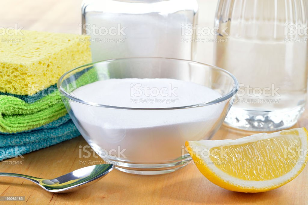 Lemon, baking soda, vinegar, salt as natural house cleaner stock photo