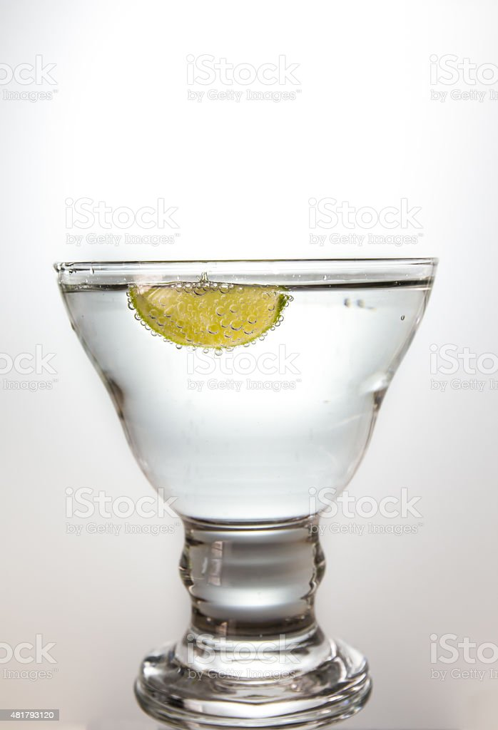 Lemon bubble float in the water in transparent glass stock photo