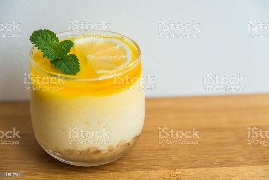 Lemon cheese cake on wooden plate with white background stock photo