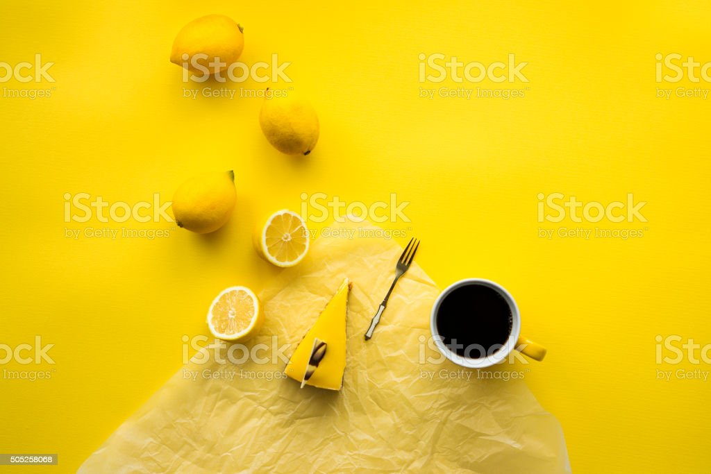 Lemon cheesecake and coffee stock photo