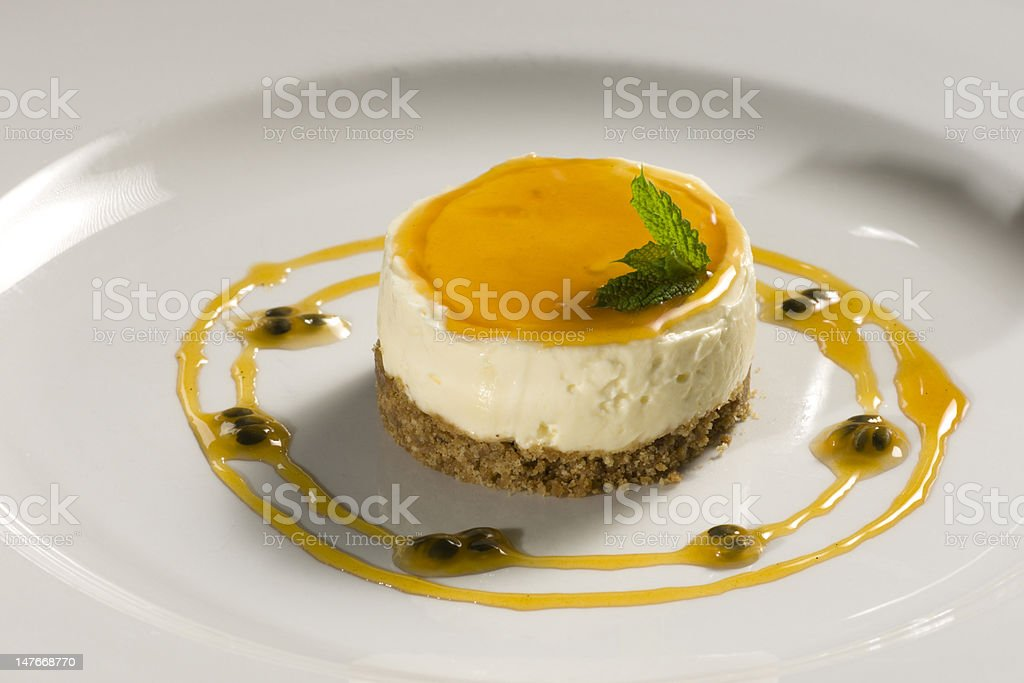 Lemon cheesecake with passionfruit jus royalty-free stock photo