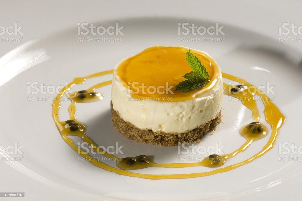 Lemon cheesecake with passionfruit jus stock photo