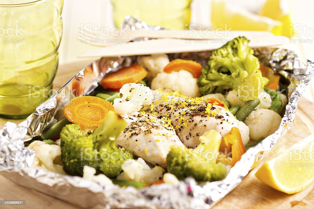 Lemon chicken with vegetables cooked in foil royalty-free stock photo