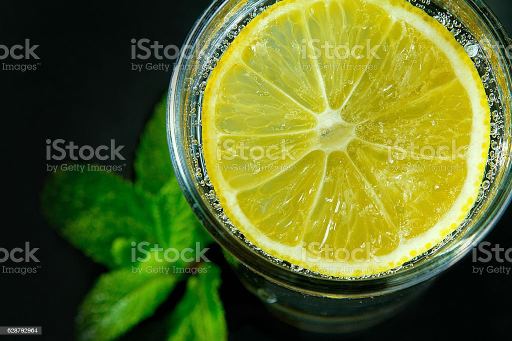 Lemon drink on the black background royalty-free stock photo