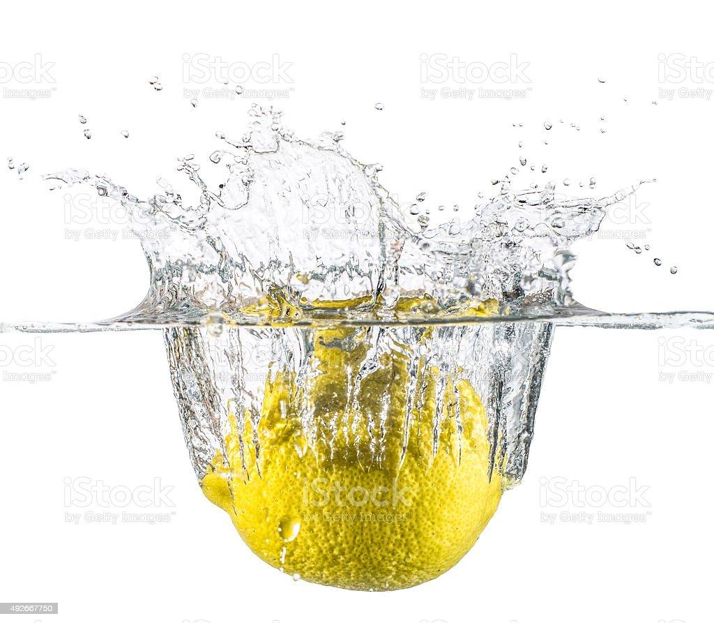 lemon drop under water splash studio shot flash white stock photo