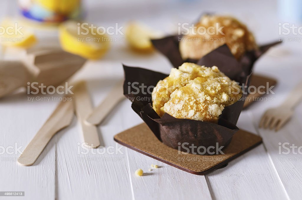 Lemon flavoured muffins on white wooden background stock photo