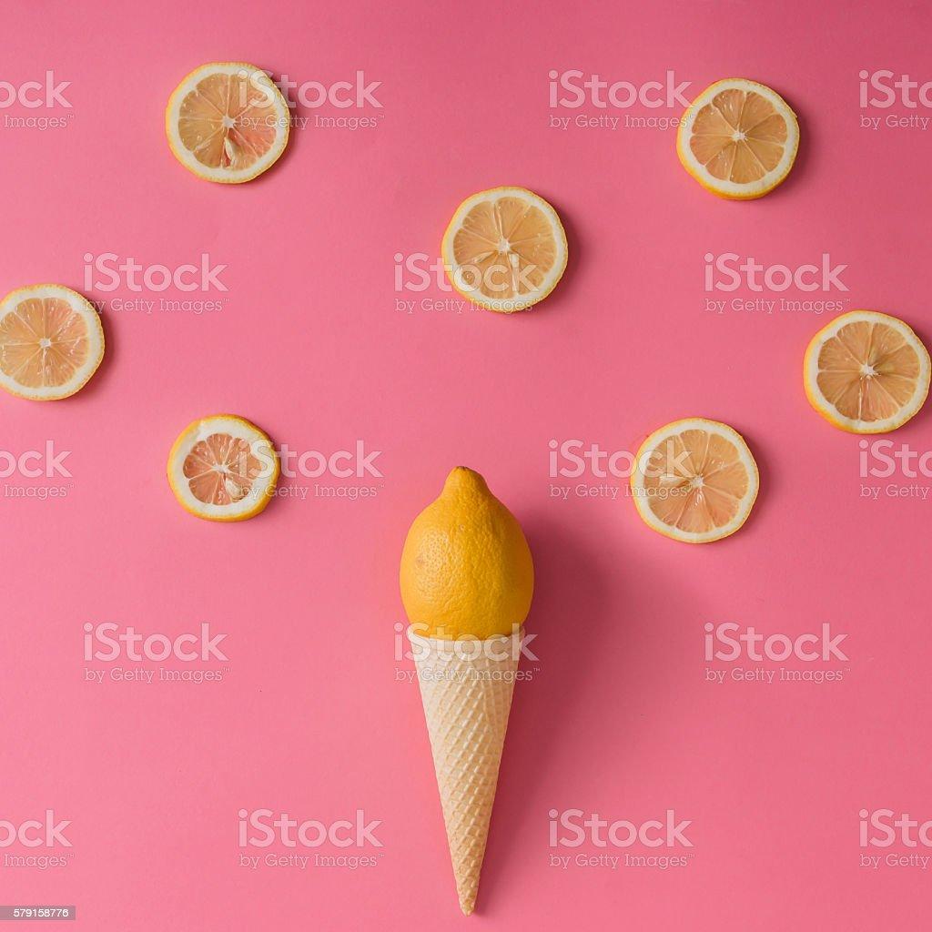 Lemon fruit in ice cream cone with lemon slices stock photo