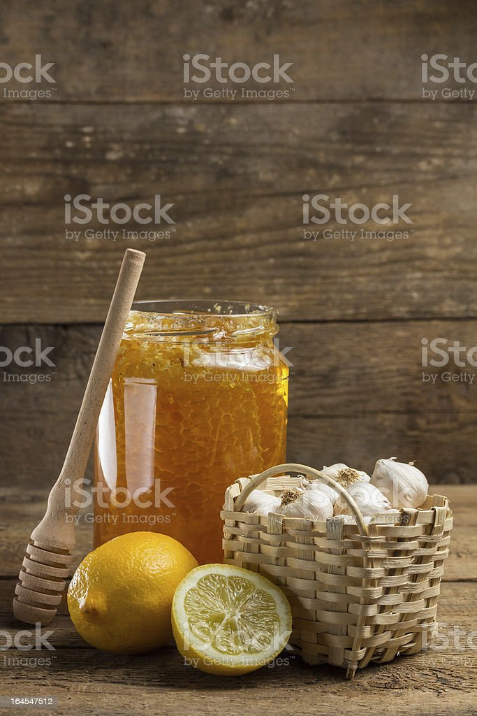 Lemon, garlic and jar of honey royalty-free stock photo