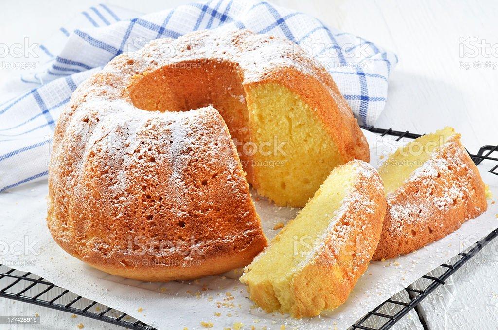 lemon gugelhupf with icing sugar stock photo