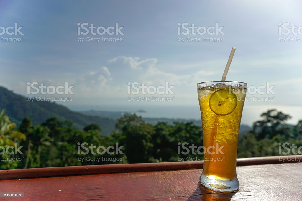 Lemon ice tea glass with sea view stock photo