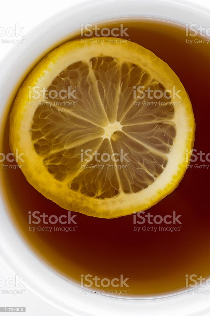 Lemon in a cup with fragrant tea. stock photo