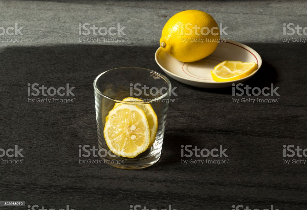 Lemon in a glass stock photo