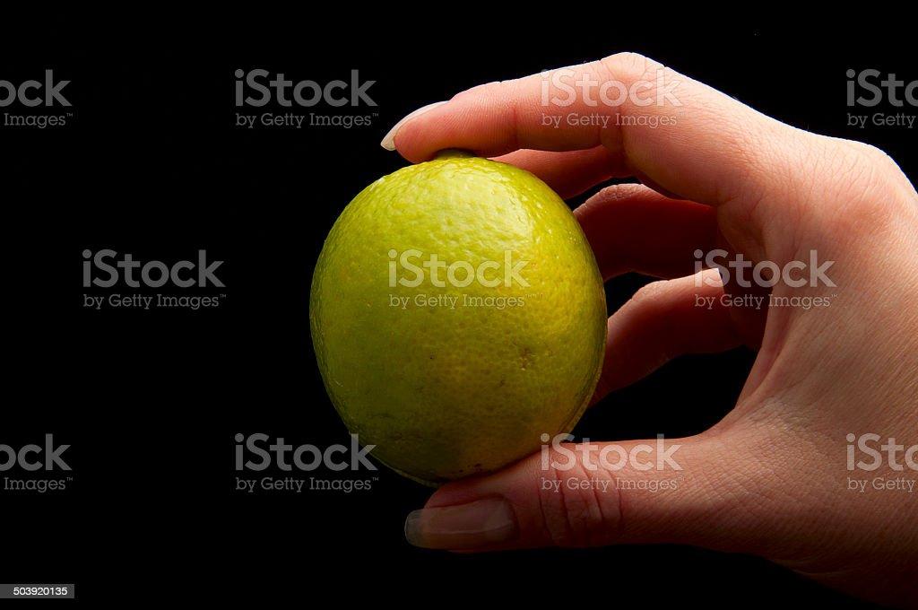 lemon in hand stock photo