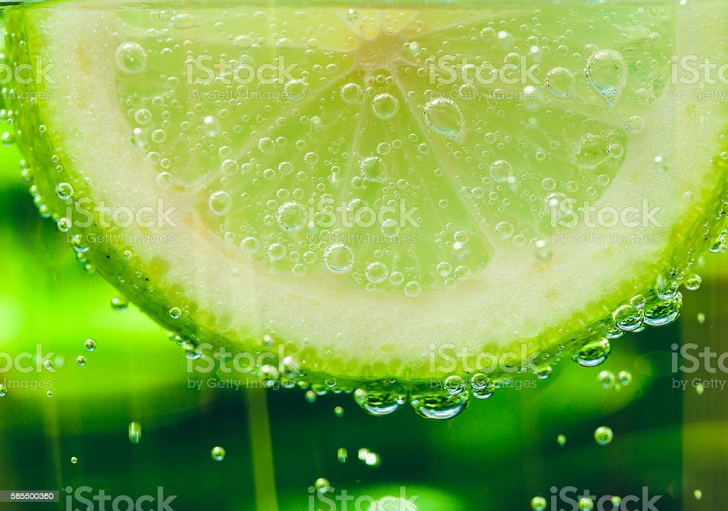 lemon in sparcle water drops stock photo
