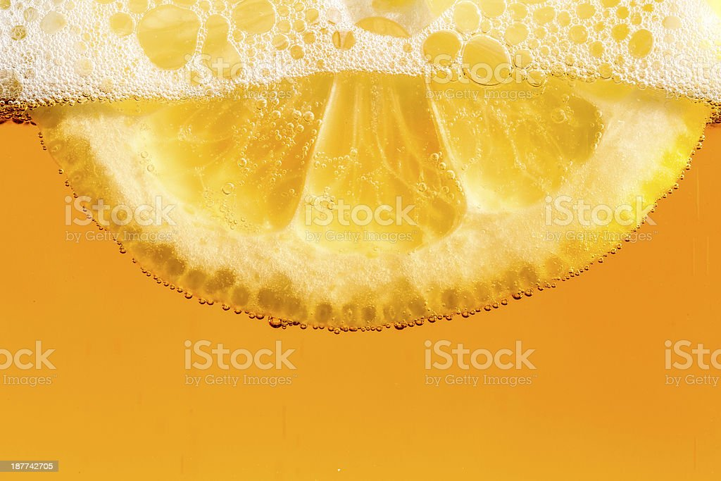 Lemon in the beer bubbles royalty-free stock photo