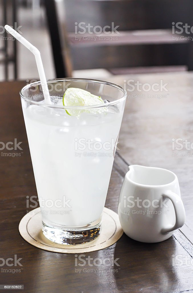 lemon juice or lime juice in glass stock photo