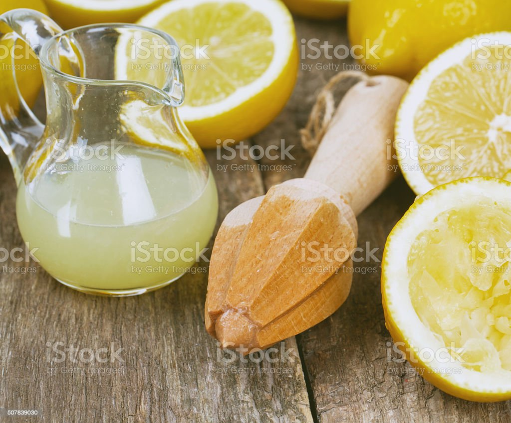 lemon juicer on an old wooden table stock photo