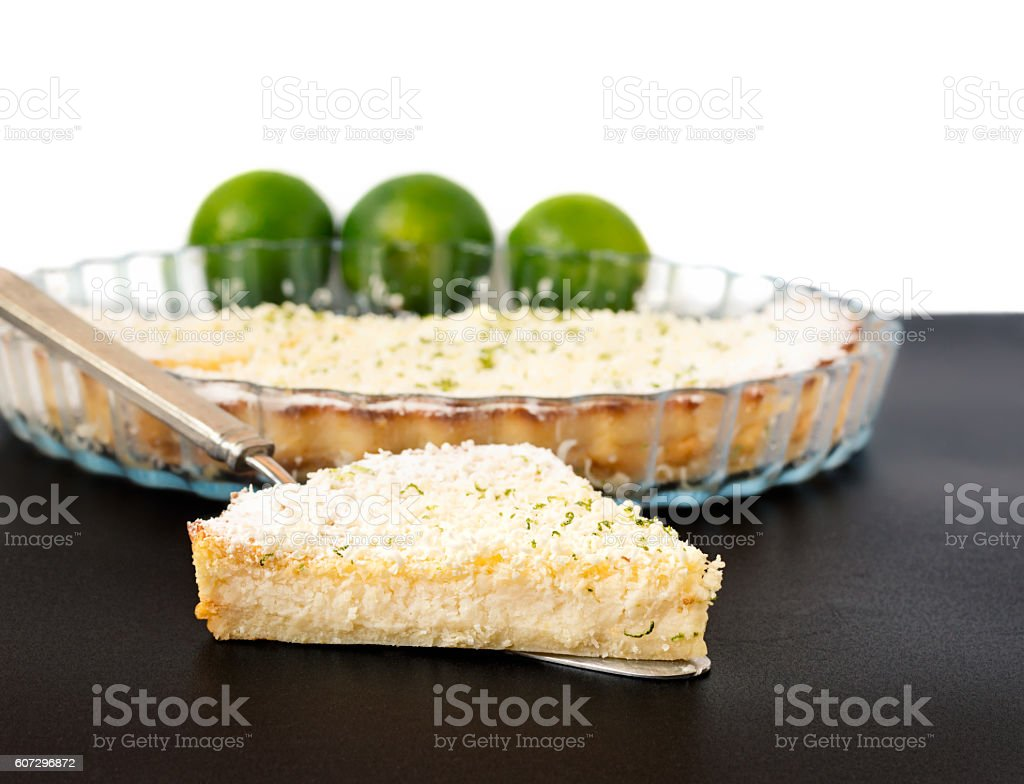 Lemon Lime Impossible Pie Slice on a Silver Pie Server stock photo