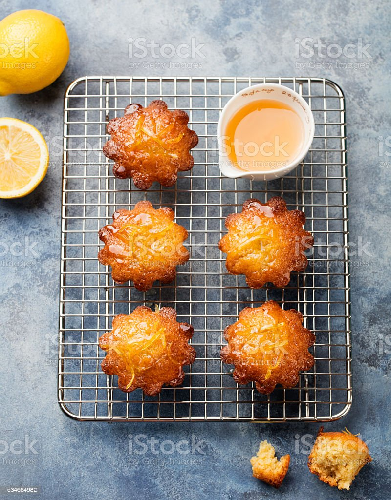 Lemon muffins cakes, financiers on a cooling rack stock photo