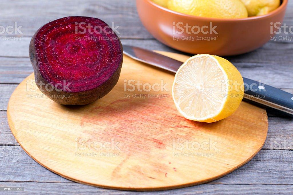 Lemon on a cutting board stock photo