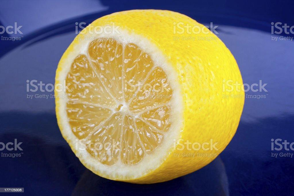Lemon on blue dish royalty-free stock photo