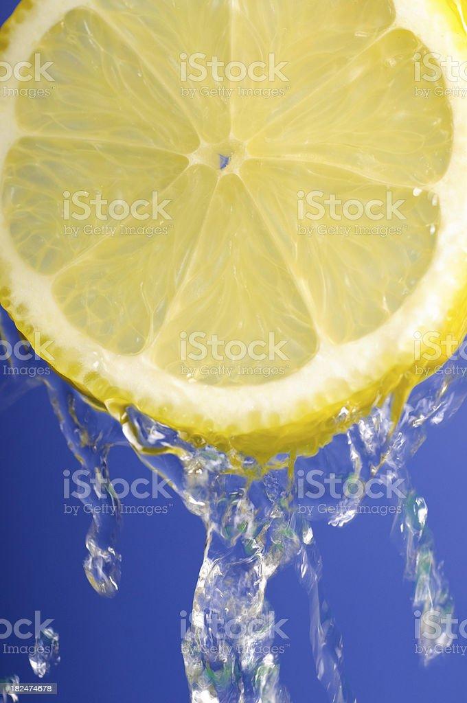 Lemon on blue stock photo