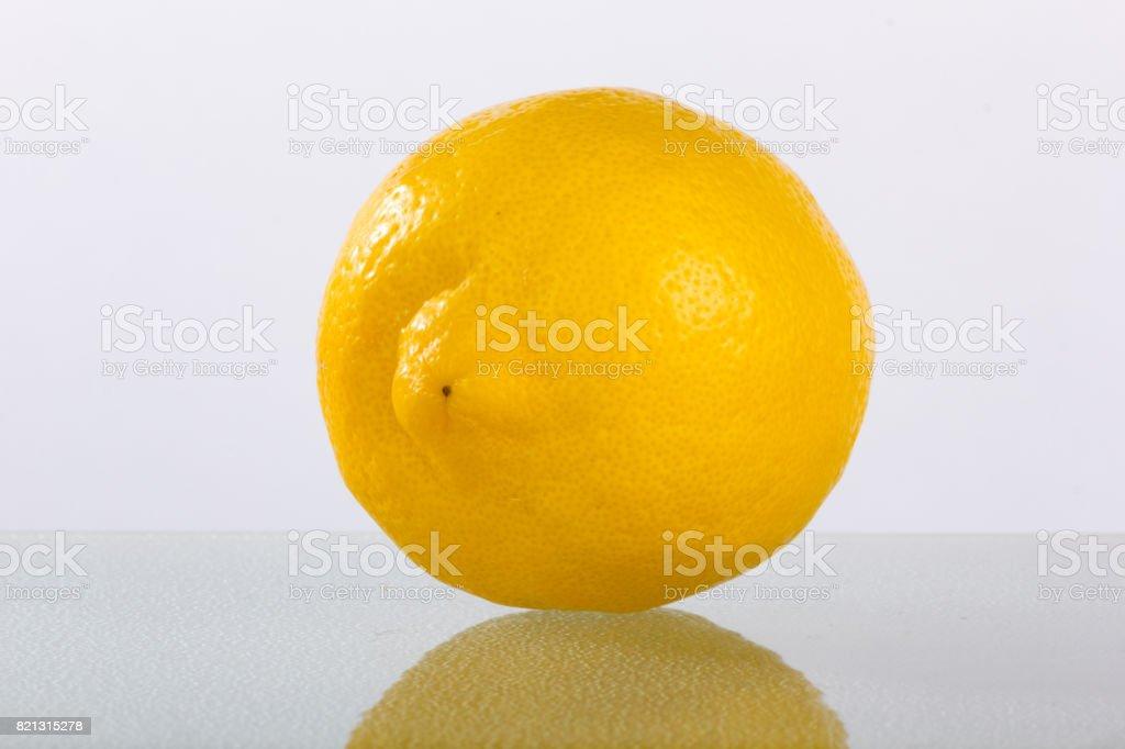 Lemon on Plain Background with Reflection stock photo
