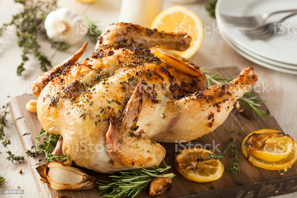 Lemon pepper chicken curing as it sits to be served stock photo