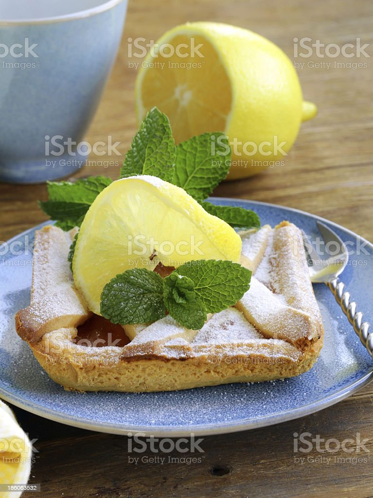 lemon pie with mint leaves and powdered sugar royalty-free stock photo