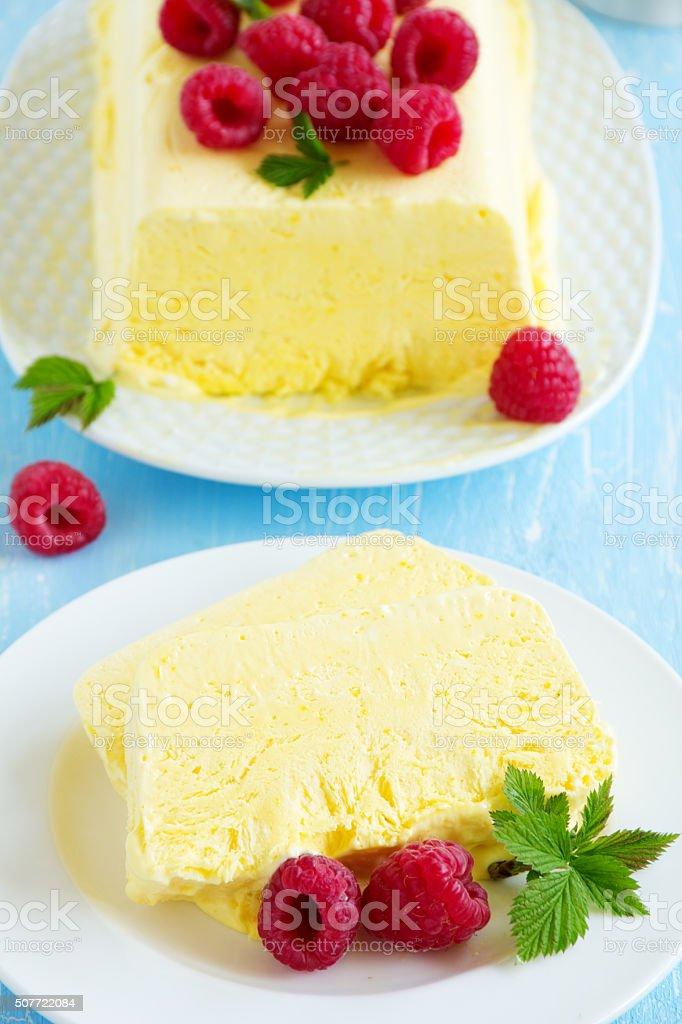 Lemon Semifreddo with raspberry. stock photo