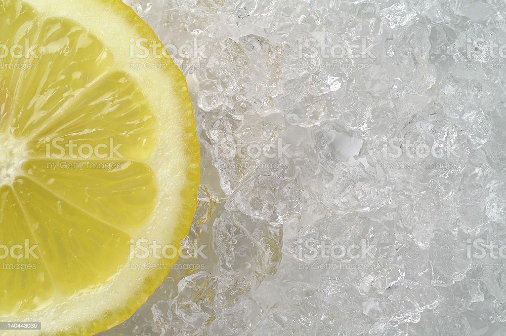 Lemon slice on crushed ice (1) stock photo