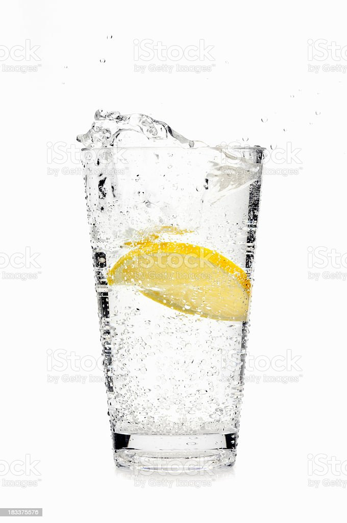 Lemon slice splashing into soda water royalty-free stock photo