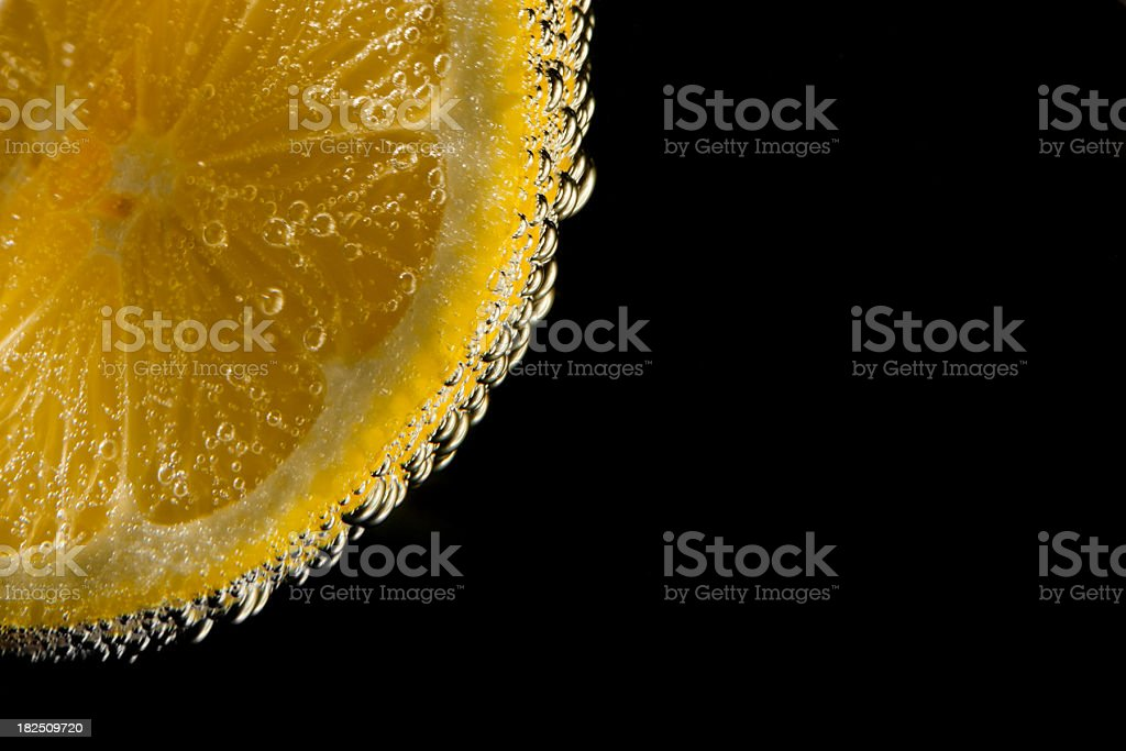 lemon slice with water drops stock photo