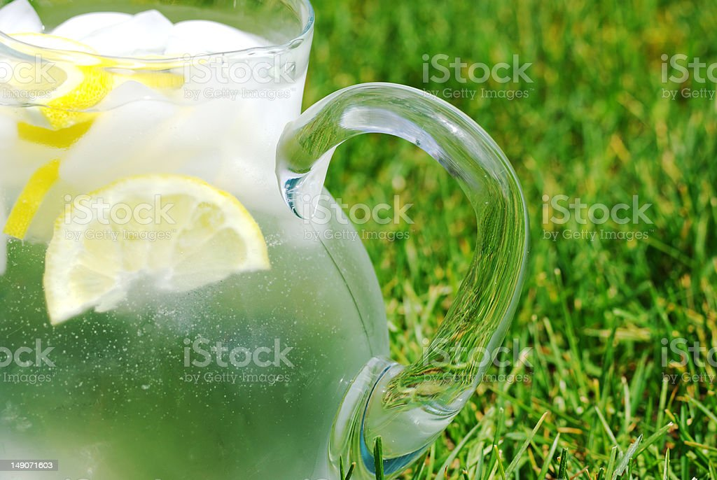 Lemon slices and ice in glass pitcher royalty-free stock photo
