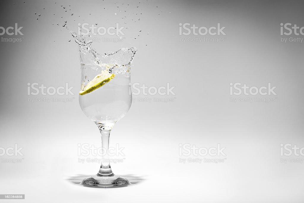 Lemon Splashing into a Glass of Soda royalty-free stock photo