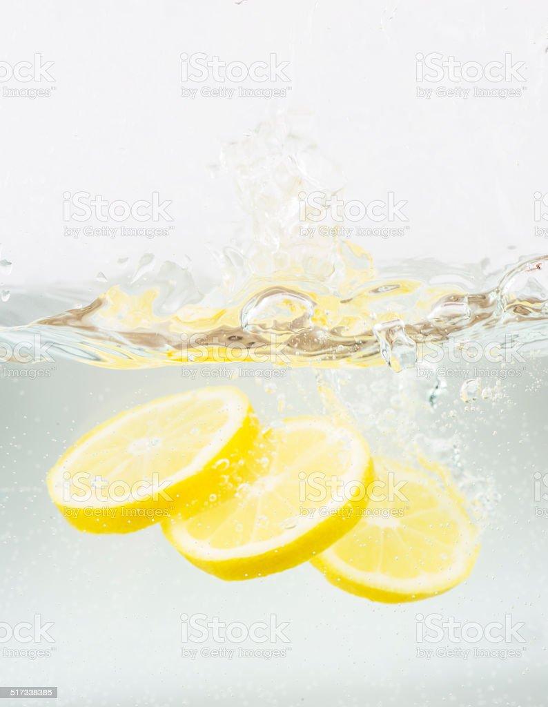 Lemon Splashing into Water stock photo
