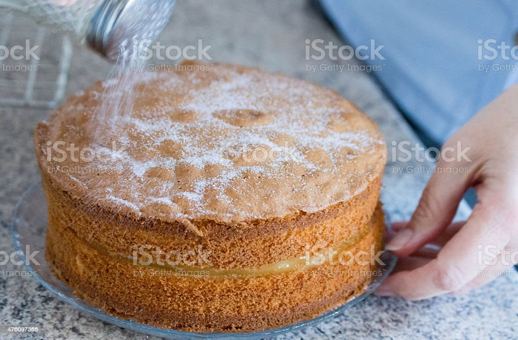 Lemon sponge cake with sugar poured over the top stock photo