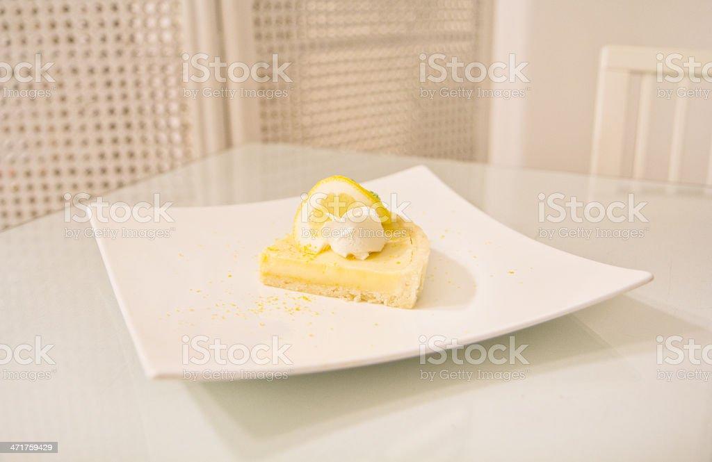 lemon tart on white dish royalty-free stock photo
