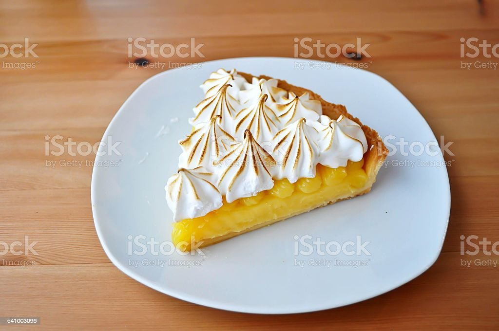Lemon Tarts in plate white on wooden table. stock photo