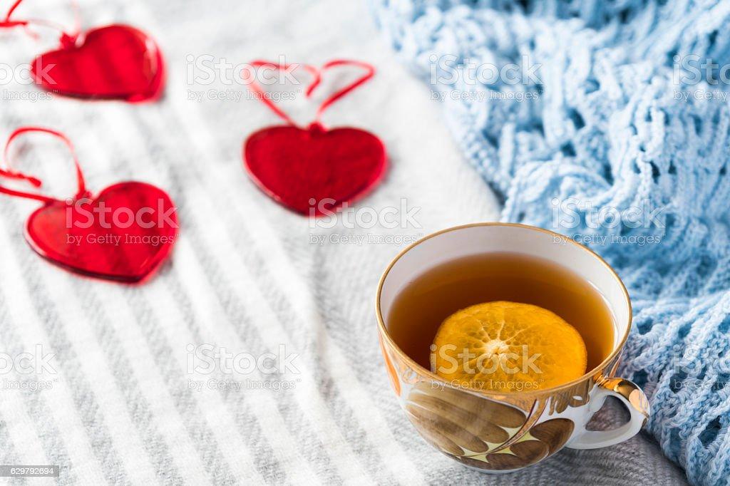lemon tea on knitted blanket stock photo