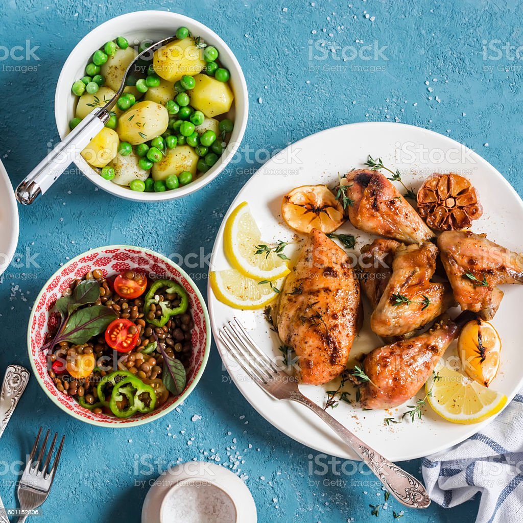 Lemon thyme chicken, potatoes, green peas, lentils salad stock photo