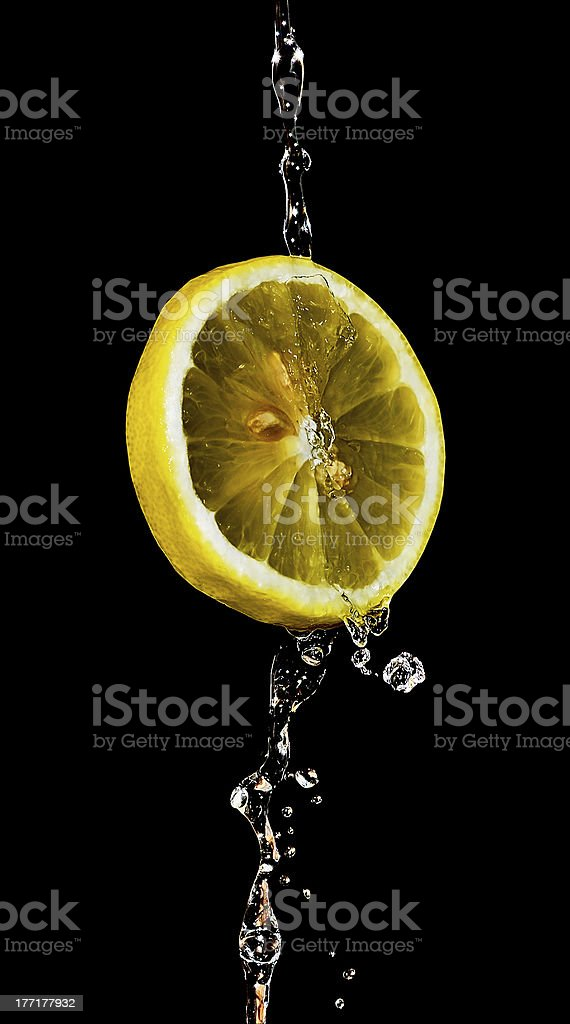Lemon under the tap royalty-free stock photo